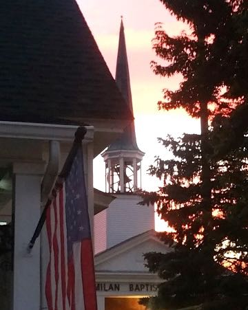 Flag and church at sunset.jpg